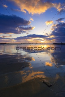Calm and colorful sunset on the beach at the sea