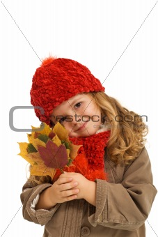 Little girl holding autumn leaves
