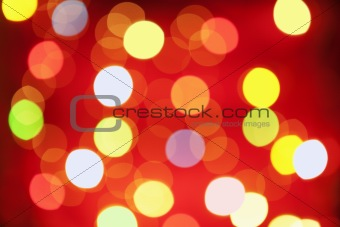 Abstract Christmas lamp arranged on red background