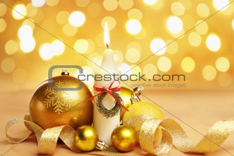 Golden Christmas ornament and candle with blur light