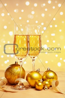 Champagne and golden Christmas ornaments