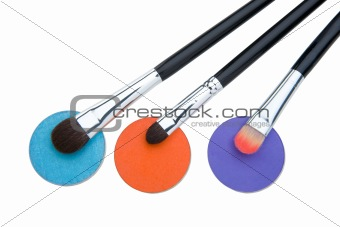 Cosmetics and brushes for a make-up on a white background