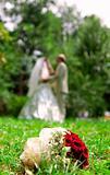 Newly-weds in summer, wedding bouquet