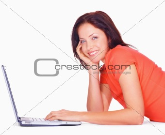 Portrait of a young smiling woman with a laptop over white