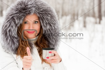 A beautiful caucasian girl drinking hot coffee