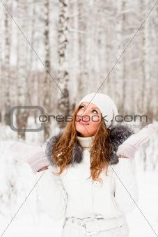 Woman wearing white in snowy woods