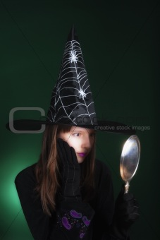 portrait of an eleven years old girl dressed as a witch