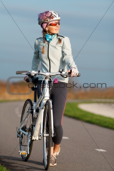 Active young woman with her bicycle