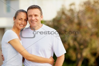 Smiling mature couple standing together outdoors