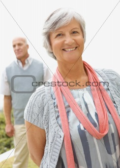 Portrait of a lovely happy senior woman smiling outdoors
