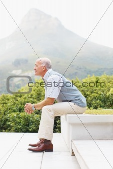 Vacation - Side of a old man sitting against nature background