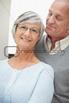 A lovely romantic senior man and woman smiling
