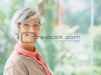 Portrait of a confident senior woman smiling with copy space