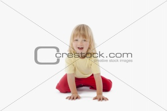 boy with long blond hair sitting, looking at camera - clipping path