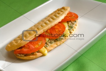 tuna tomato and cheese grilled panini sandwich