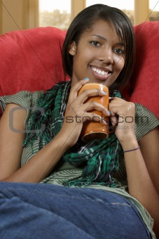 Beautiful female relaxing with coffee