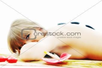 Massage with hot volcanic stones