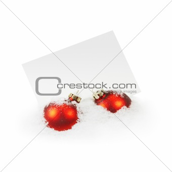 Christmas Balls and an Empty Greeting Card on the White Snow
