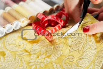 cutting the yellow silk cloth