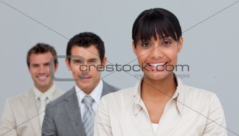 Afro-American businesswoman smiling at the camera with her colle