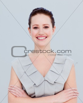 Portrait of a smiling beautiful businesswoman with folded arms