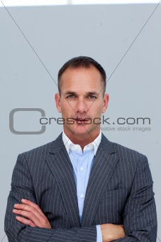 Portrait of confident businessman with folded arms