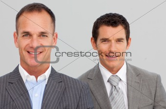 Portrait of confident businessmen with folded arms
