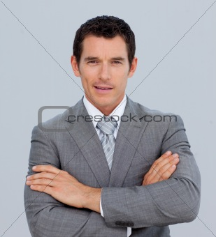 Portrait of smiling businessman with folded arms