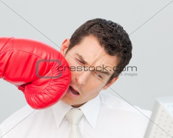 Boxing a businessman in his face
