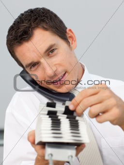 Attractive businessman on phone holding a card holder