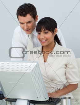 Businessman and Afro-American businesswoman in the office