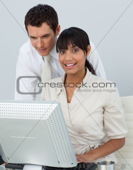 Smiling Afro-American businesswoman with her colleague in the of