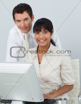 Afro-American businesswoman and caucasian businessman in the off
