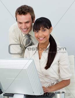 Attractive business colleagues using a laptop