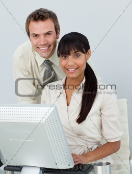 Business colleagues using a laptop
