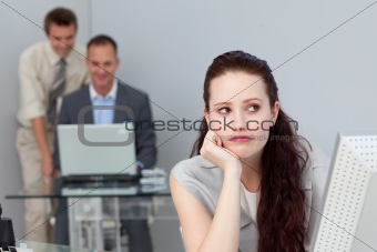Thoughtful businesswoman using a computer in a company