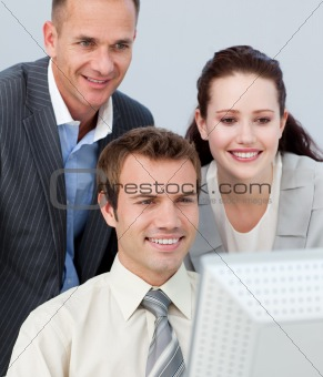 Portrait of business people working together with a computer