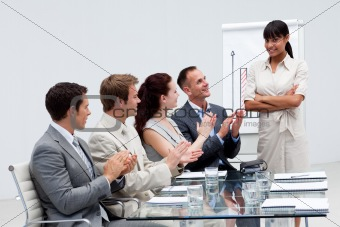 Business people applauding a colleague after giving a presentati