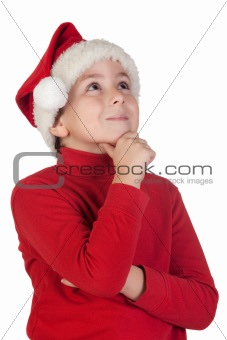 Adorable boy with santa hat thinking