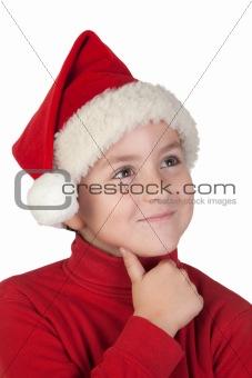 Adorable boy with santa hat thinking