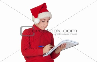 Beautiful child writing his Christmas letter