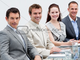Portrait of business people sitting in a meeting