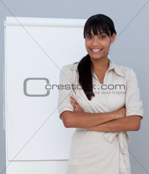 Smiling Afro-American businesswoman giving a presentation