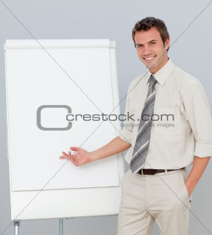 Smiling businessman giving a presentation in the office