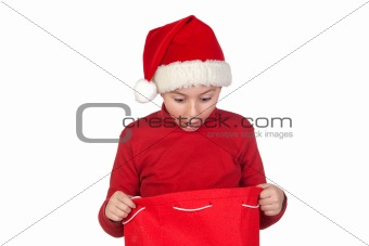 Amazed boy looking in the Christmas bag
