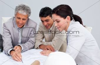 Portrait of architects studying plans