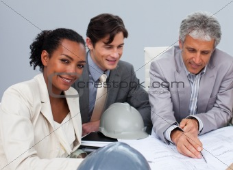Architectural multi-ethnic business team working in the office