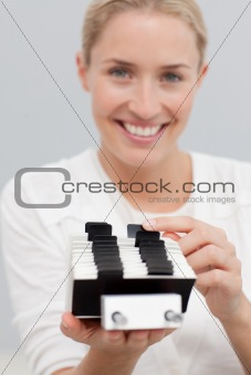Attractive businesswoman looking at an index holder in the office