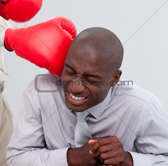 Portrait of an Afro-American businessman being boxed