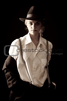 Beautiful girl in a suit and hat